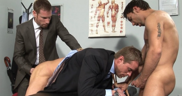 Billy Berlin and Lucky Daniels hold down Neil Stevens
