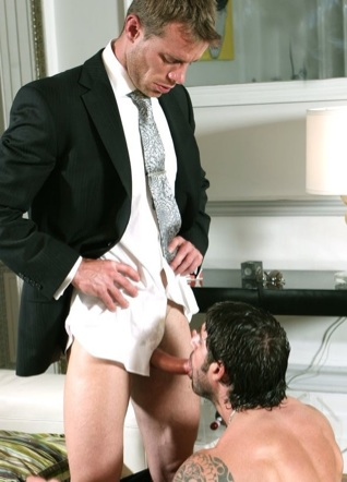 Axel Brooks sucking suited Neil Steven's cock