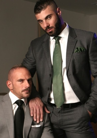 Samuel Colt and Alex Marte in suits