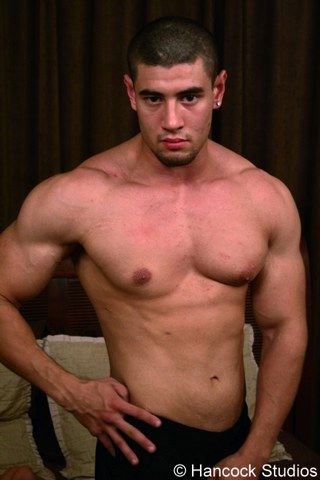 Shirtless guy with big muscular shoulders