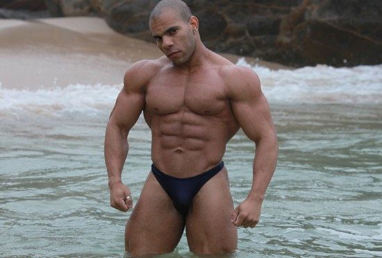 Muscle boy Lucius shows off his ripped abs and huge deltoids at the beach