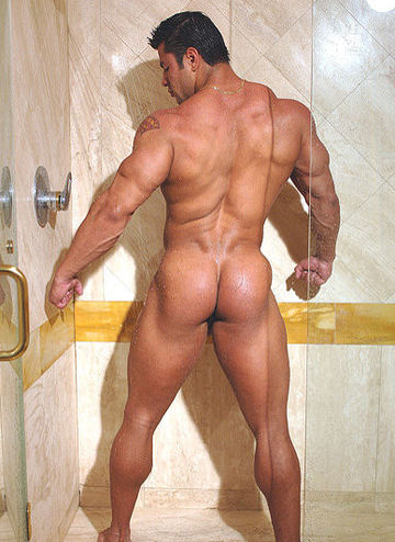 Massive muscled bodybuilder in the shower