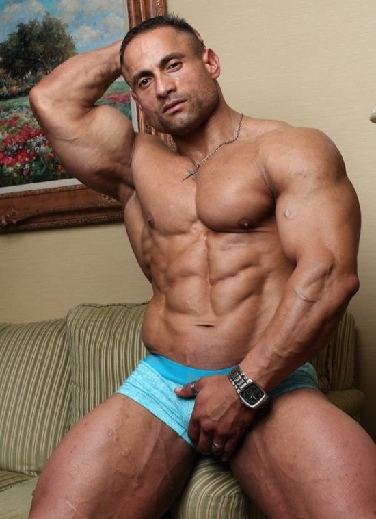 Huge bodybuilder Gil flexes in his underwear