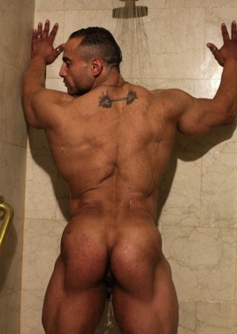 Gil shows off his smooth muscle ass in the shower