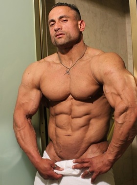 Huge bodybuilder Gil Dela Cruz in a towel