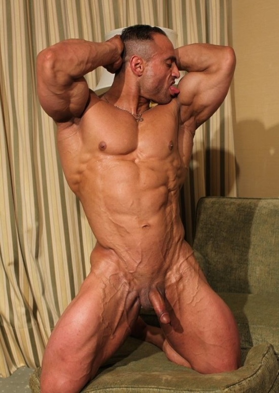 Huge ripped body builder Gil licks his bicep