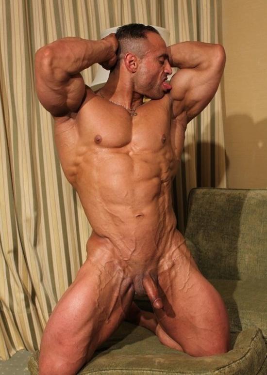 Huge ripped body builder Gil licks his bicep