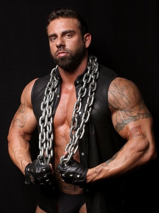 Bearded Xavier shows off his huge inked biceps