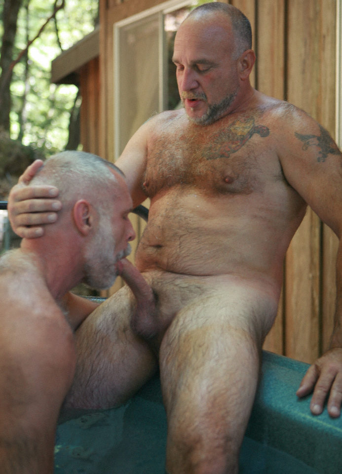 Tattooed bear getting blown in hot tub