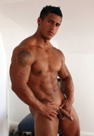 Hot latin muscle stud Timmy Riordan shows off his big muscles and fat uncut cock