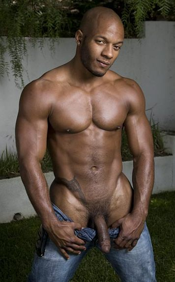 Muscled Black dude shows his huge soft cock