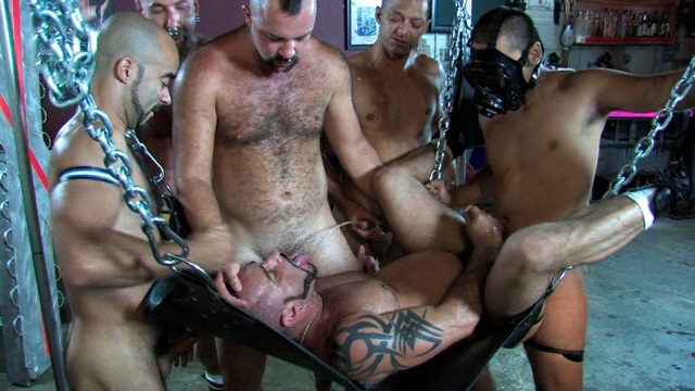 Group of studs fuck and piss on Marco Cruise in the sling