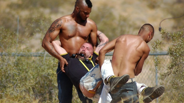 Jake Wetmore gagged and carried off by two black tops