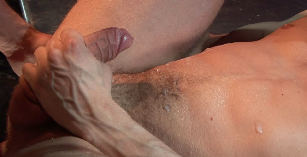 Uncut cock blowing a load on a slightly hairy belly