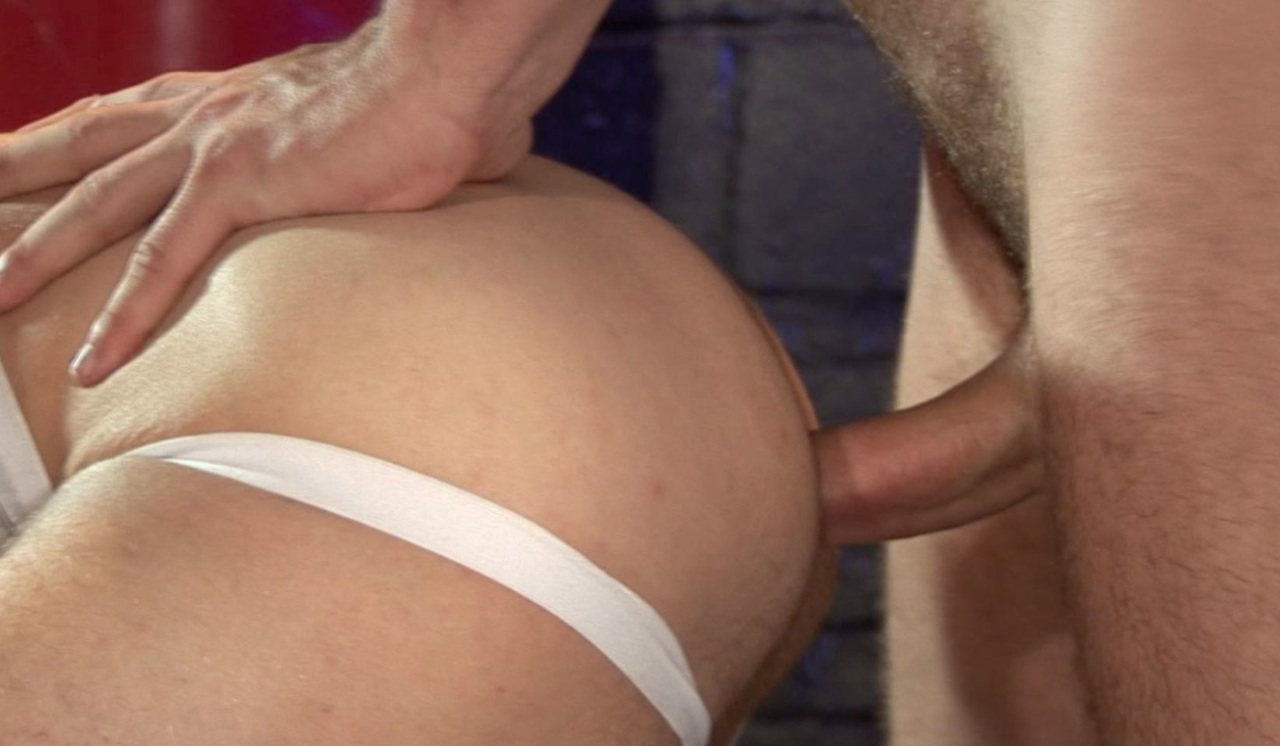 Bottom in a jockstrap bends over and takes a big dick up his ass bareback
