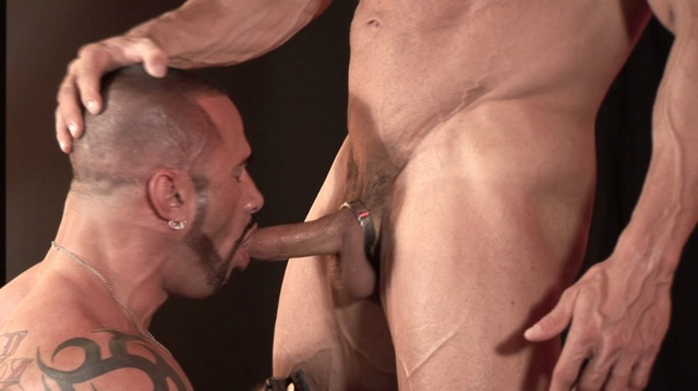 Marco Cruise on his knees sucking Jim's big dick