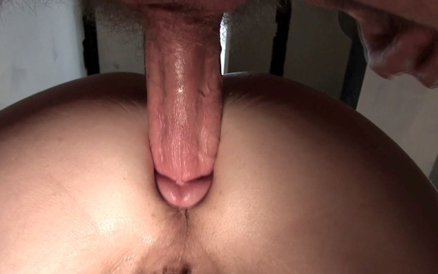 close up of fat cock being intserted into smooth hole