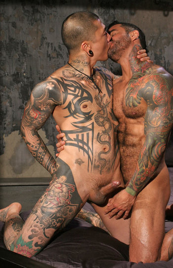 Heavily inked studs kissing with hard cocks