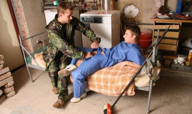 Young soldier tears open a buds pants