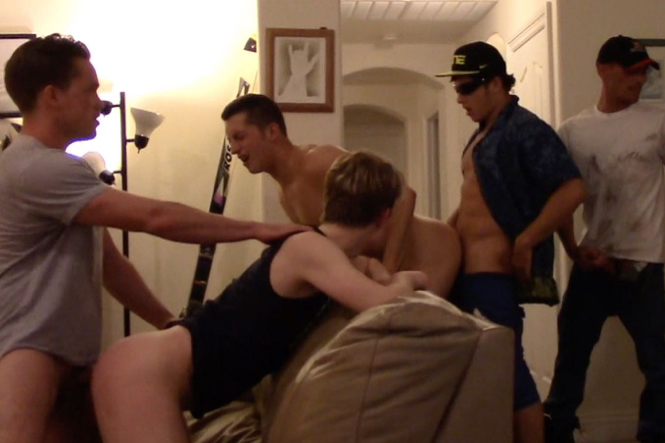Guys line up to fuck two bottoms who are bent over a couch
