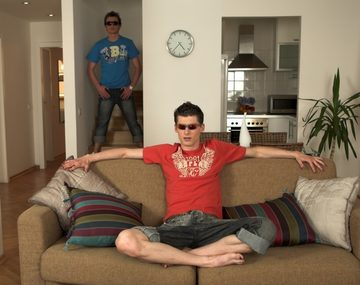 Two guys in sunglasses in an apartment