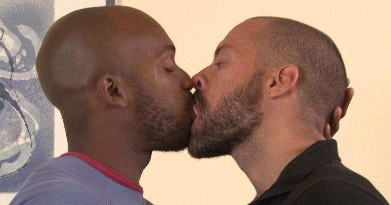 Black guy kisses Latino passionately