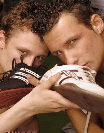 Young jocks sniff their smelly shoes