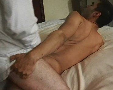 Young Asian guy pushing cock deeper in his hole