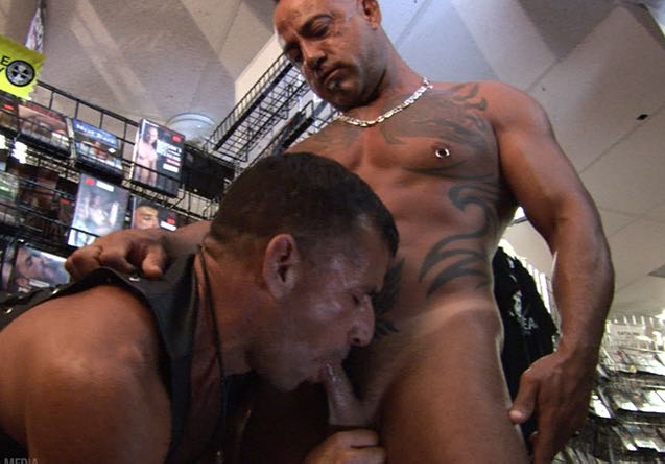 Ben Venido sucks Bo Bangor's hard cock in an adult bookstore