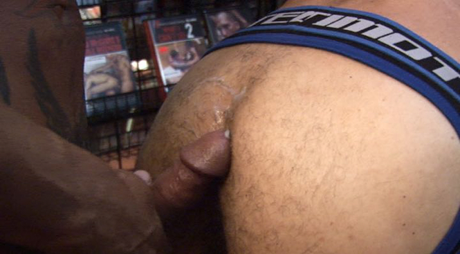 Hard cock spurting cum on a hairy ass