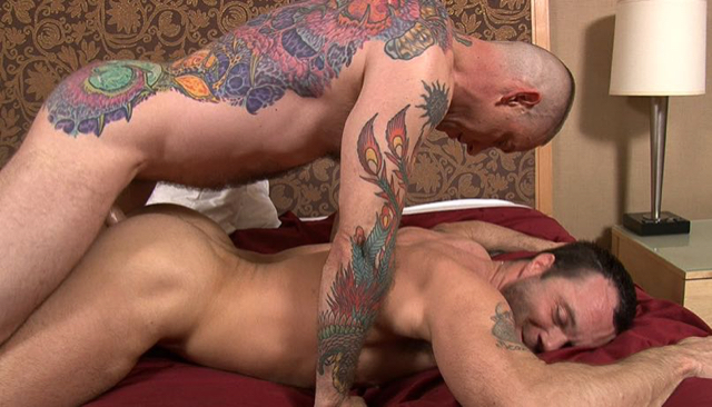 Drew Sumrok smiles as Luke Thomas pounds him bareback inside his muscle ass