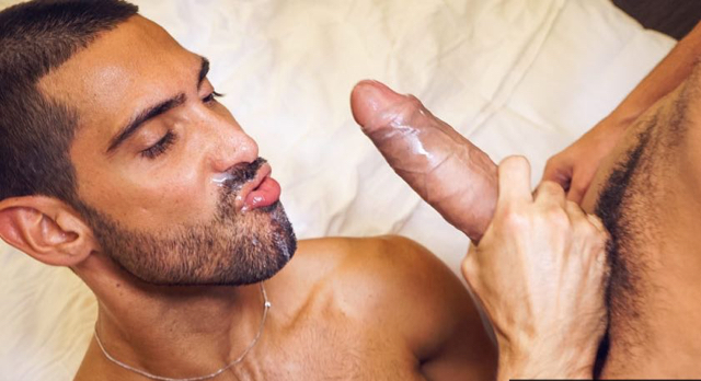 Scruffy Alejandro Dumas worships the huge cock that just painted his beard with cum