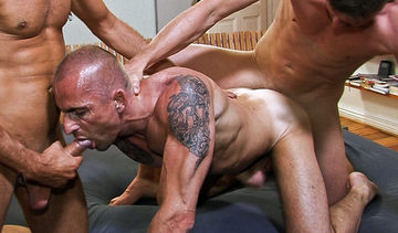 Kriss sucking Risto\'s cock while Roman pounds his tight ass