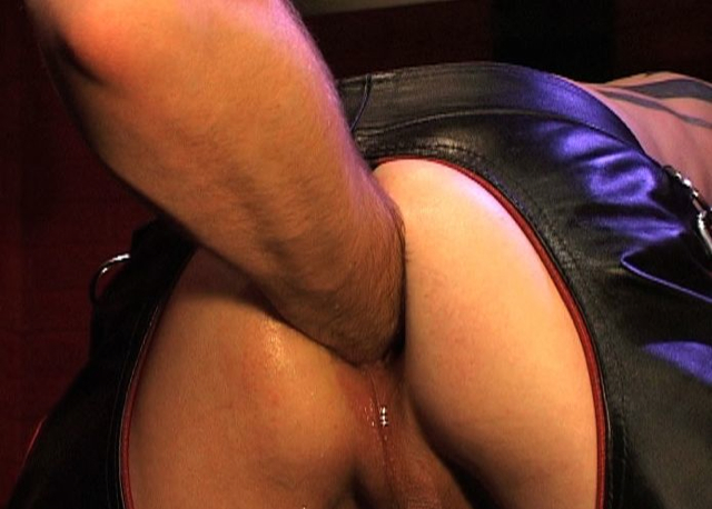 Smooth ass in leather chaps gets fisted