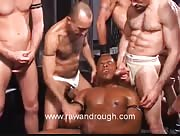 Muscle Black Stud Surrounded By Piss Pigs